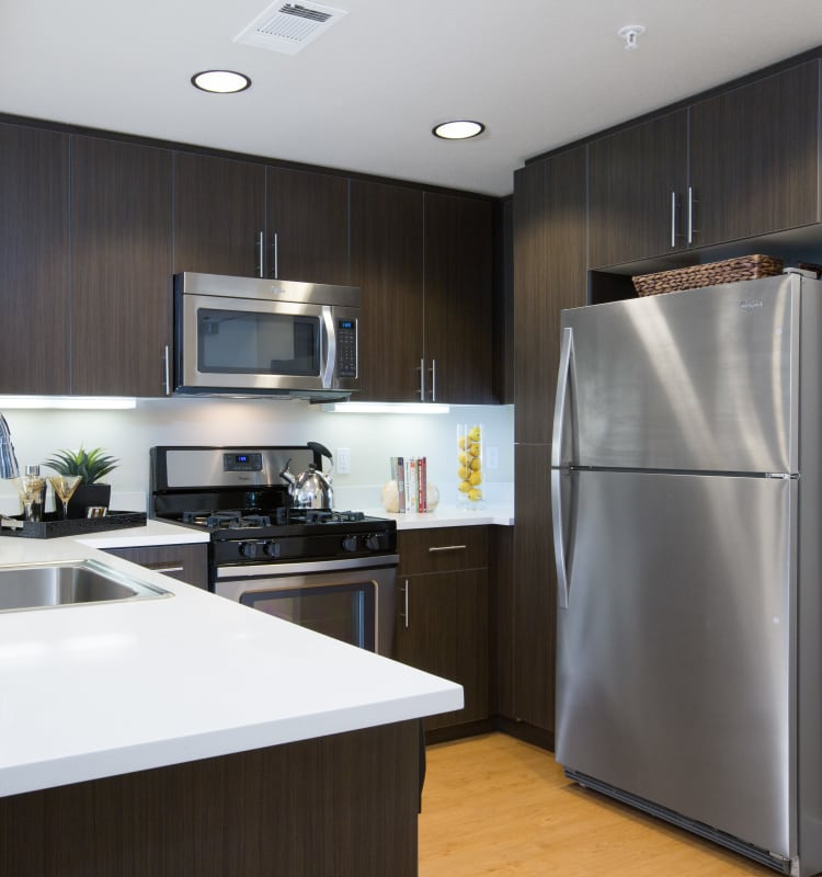 Spacious kitchen with large counter tops in a model home at Sofi Riverview Park in San Jose, California
