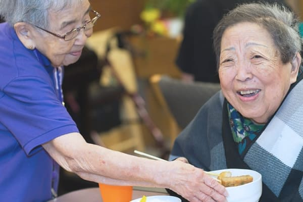 A caretaker with a resident at Nikkei Manor in Seattle, Washington