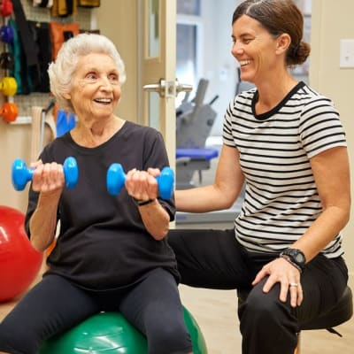 Resident with physical therapist at AgeWell Living