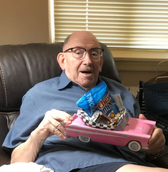 One resident poses with his personalized classic car goody bag.