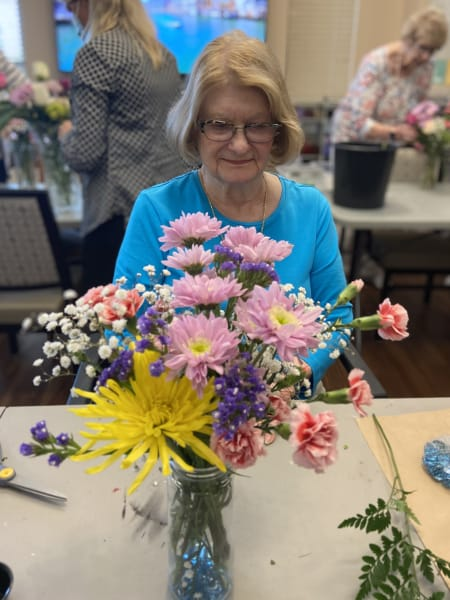 A Tacoma resident focuses on her flowers as she creates her first arrangement.