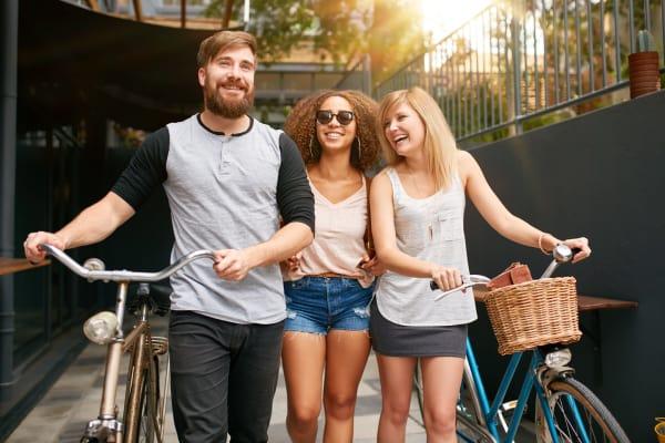 Friends going for a bike ride near Newnan Lofts Apartment Homes in Newnan, Georgia