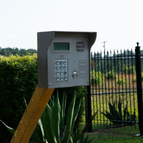 Keypad at the entrance gate of Red Dot Storage in Covington, Louisiana