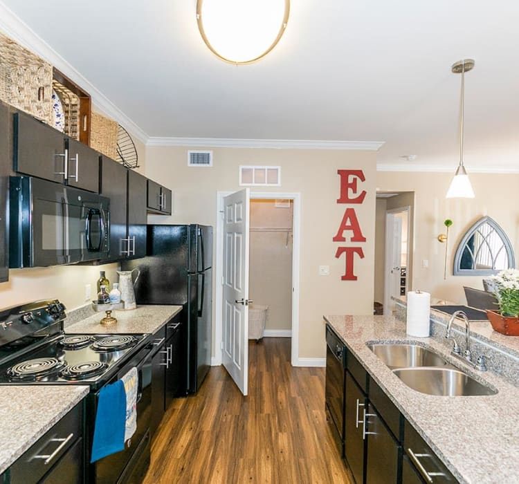 Modern kitchen in model home at Hilltops in Conroe, Texas