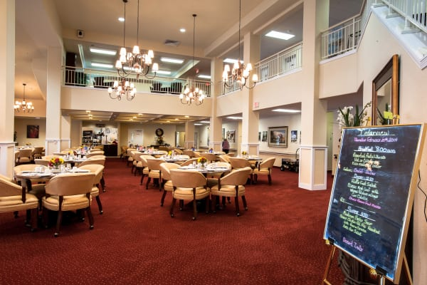 A large community dining room at Cedarview Gracious Retirement Living in Woodstock, Ontario