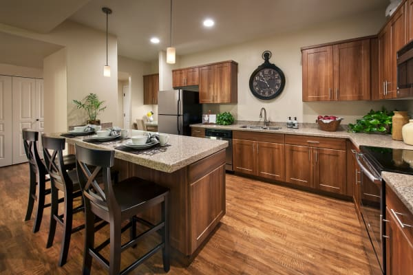 Modern kitchen with hardwood floor and granite countertops in model home at San Paseo in Phoenix, Arizona