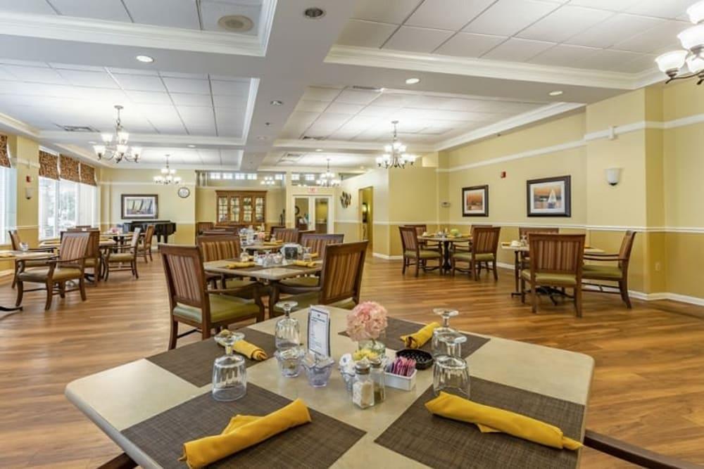 Set dining room tables at Grand Villa of Sarasota in Sarasota, Florida