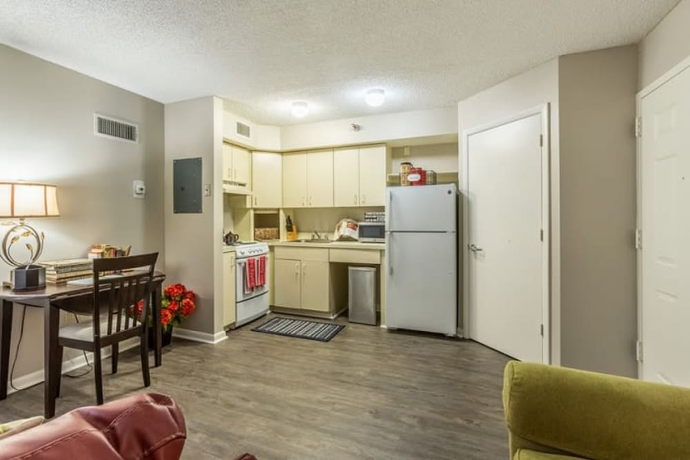 An apartment living room, dining room and kitchen at Grand Villa of Sarasota in Sarasota, Florida