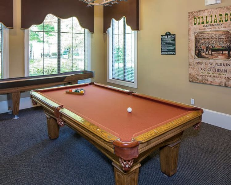 Game room with a pool table and shuffle board at Ranch ThreeOFive in Arlington, Texas