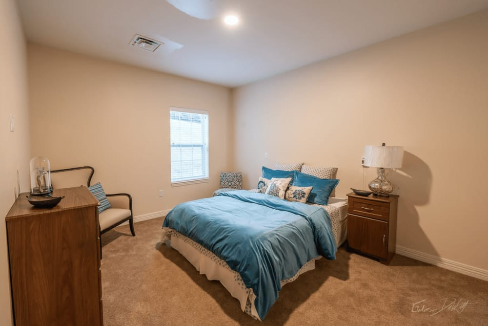 A furnished apartment bedroom at Harmony at Morgantown in Morgantown, West Virginia