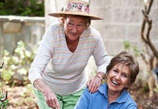 Senior living residents gardening outdoors in South Carolina