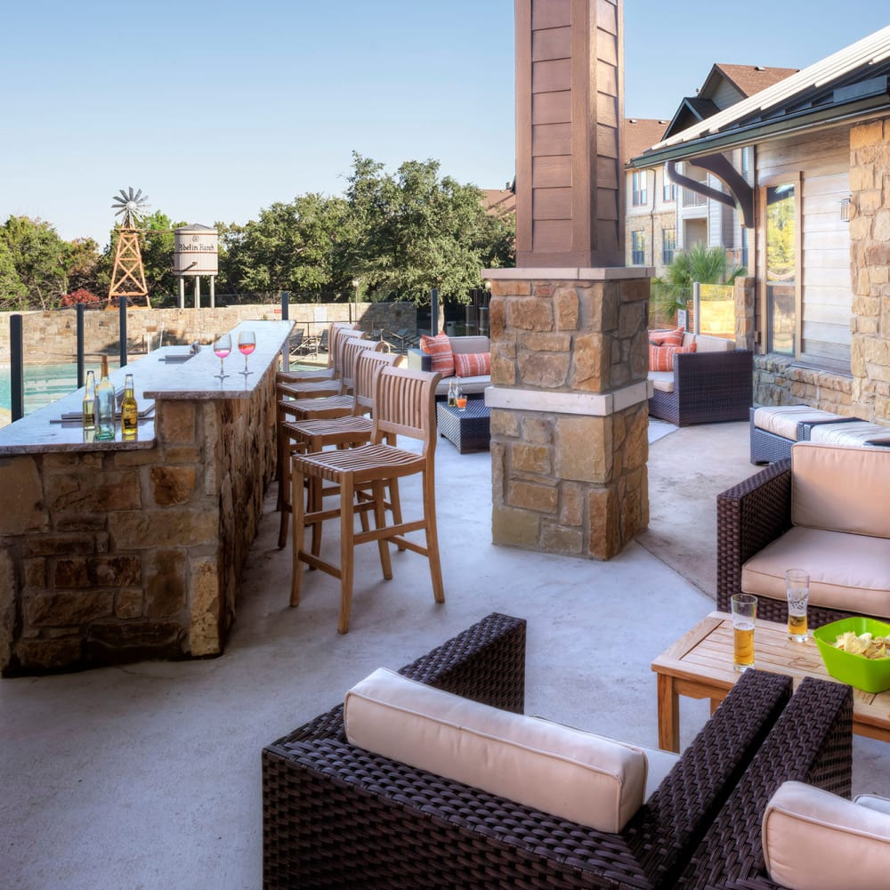 Poolside bar and lounge at The Asten at Ribelin Ranch in Austin, Texas