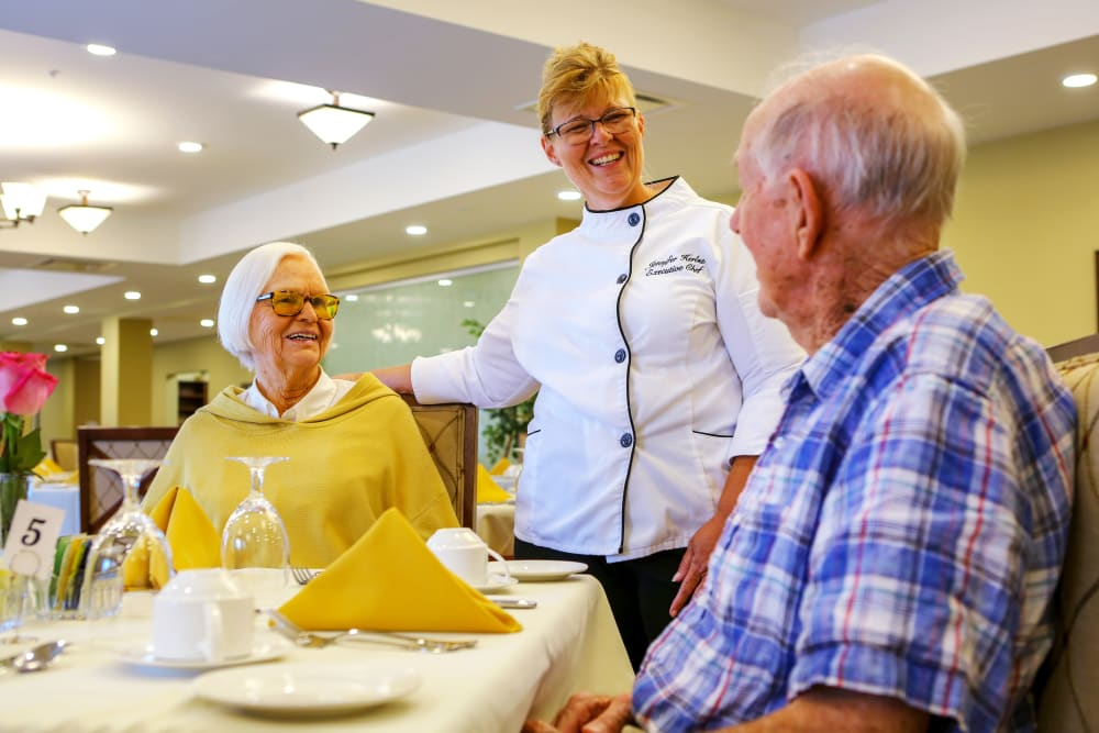 Residents with the chef in the dining room at Harmony at West Shore in Mechanicsburg, Pennsylvania
