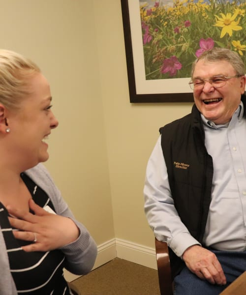 Resident and caregiver sharing a laugh at The Springs at Grand Park in Billings, Montana