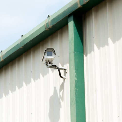 Security camera mounted on an exterior wall at Red Dot Storage in Woodstock, Illinois