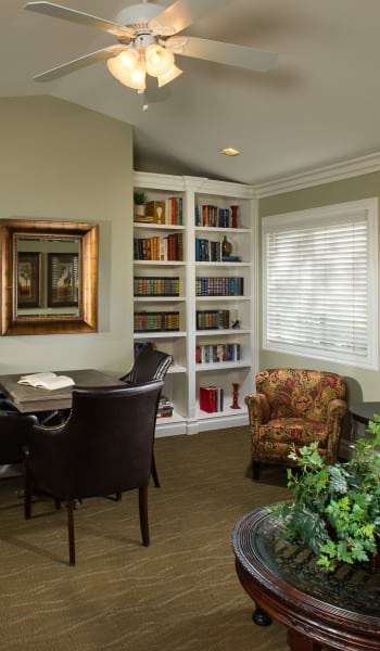Living room with bookshelves at The Villas at Rowland Heights