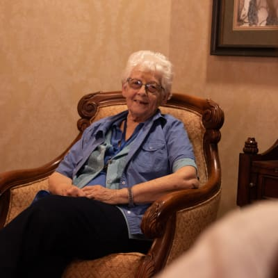 Resident talking with another resident at Deer Crest Senior Living in Red Wing, Minnesota