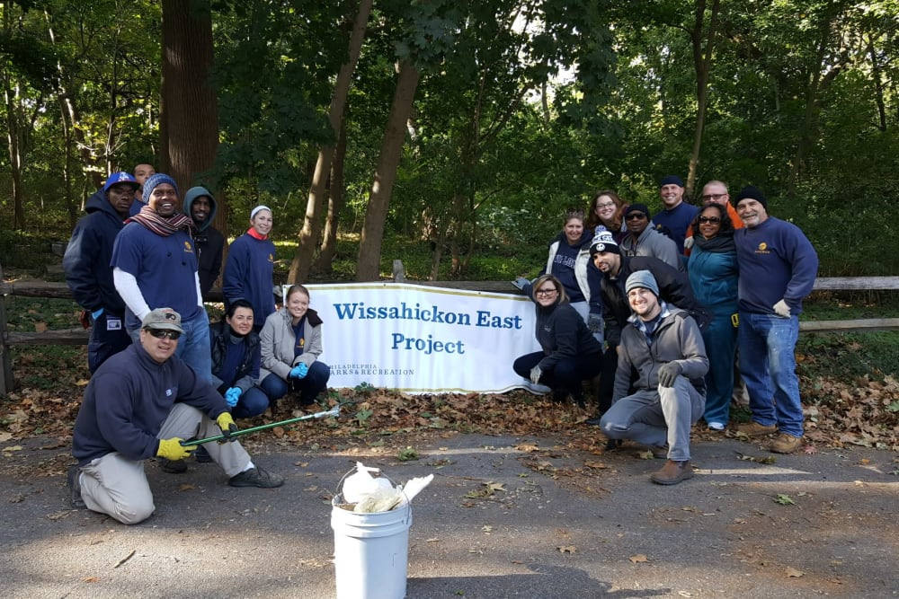 Employees at Eagle Rock Properties in Plainview, New York participating in a park cleanup.