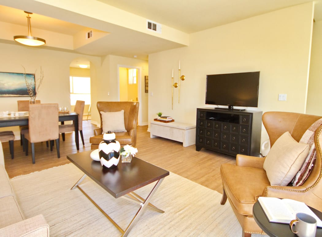 View of dining area from living room of model home at IMT Townhomes at Magnolia Woods in Sherman Oaks, CA