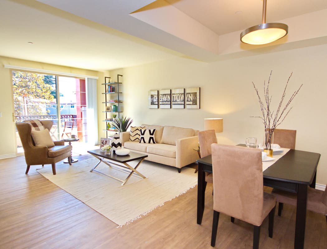 Model home living room with hardwood floors and plenty of natural light at IMT Townhomes at Magnolia Woods in Sherman Oaks, California