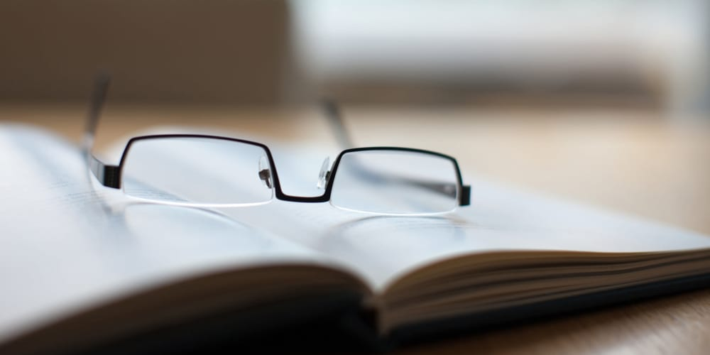 Reading glasses sitting on a book at The Springs at Sherwood in Sherwood, Oregon