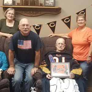 Resident Lorenz at a football party for his dare to dream event at Arlington Place Oelwein in Oelwein, Iowa.
