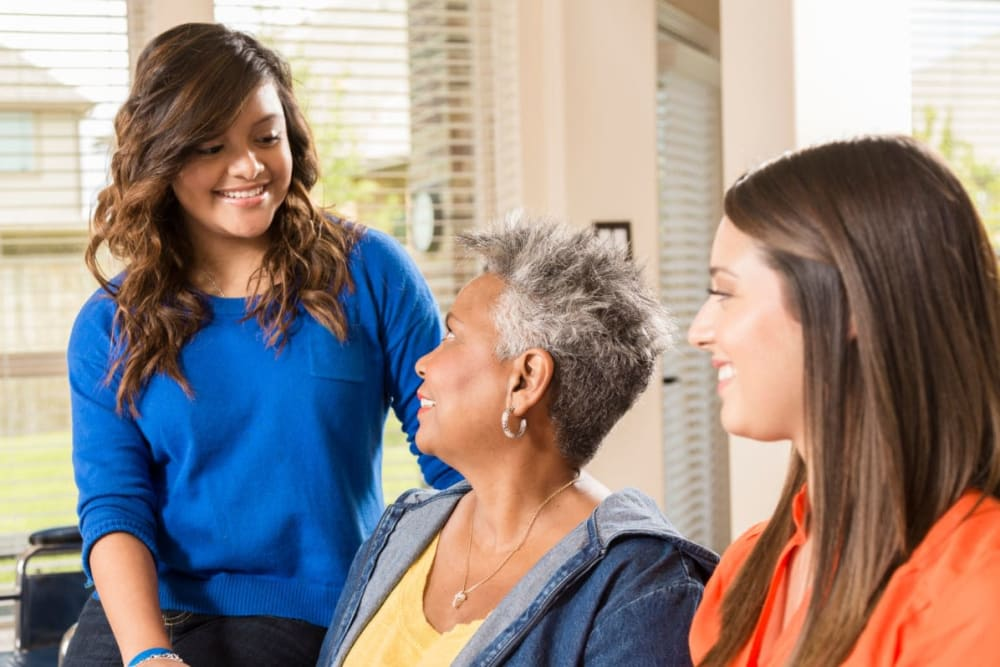 Family members visit resident at The Atrium in Rockford, Illinois