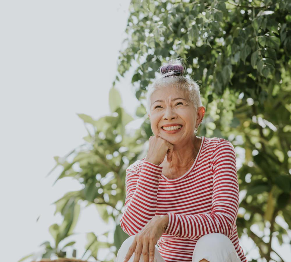 A resident enjoying the outdoors near Kingston Bay Senior Living in Fresno, California.