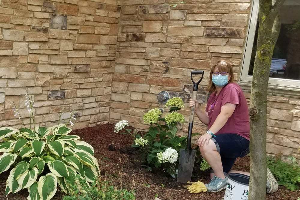 Staff assisting with resident gardening activity at Prairie Hills Senior Living in Cedar Rapids, Iowa.