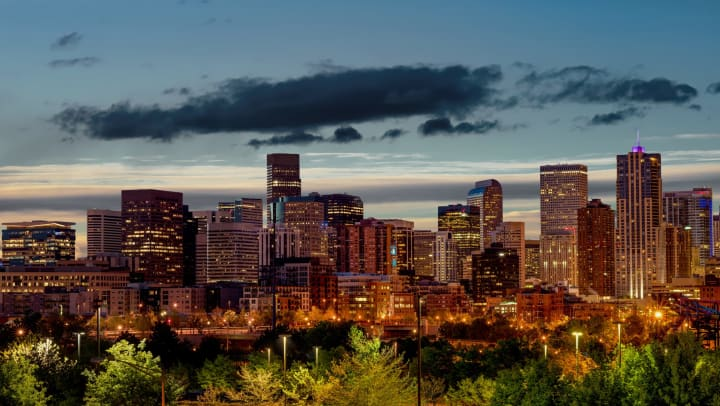 Photo of Denver skyline at dusk.