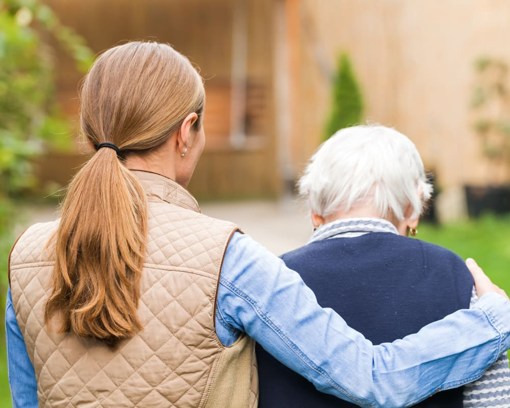 A family member taking a respite care resident into Courtyard Estates at Hawthorne Crossing in Bondurant, Iowa.