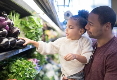 Resident and his daughter shopping for produce near Dulles Greene in Herndon, Virginia