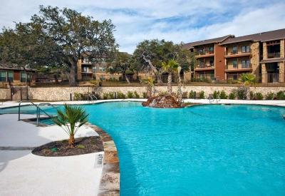 Beautiful swimming pool area at The Hills at Fair Oaks in Fair Oaks Ranch, Texas