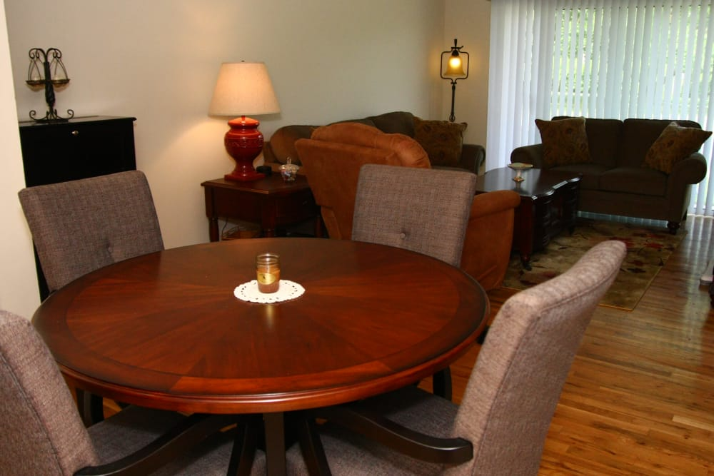 Dining table and comfy cushion chairs at model apartment at The Heights at Spring Lake in Spring Lake, New Jersey