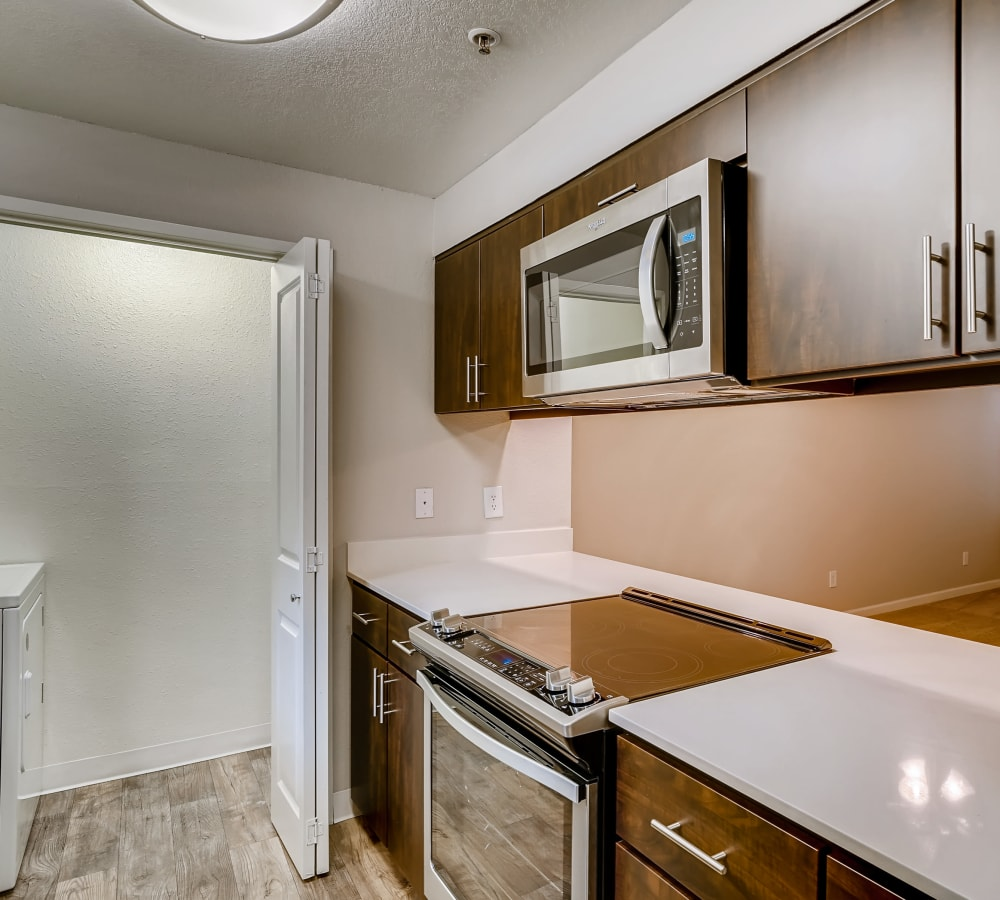 Espresso-style cabinetry at Slate Ridge at Fisher's Landing Apartment Homes in Vancouver, Washington