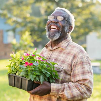 Happy resident of Mountain View Retirement Village gardening in Tucson, Arizona