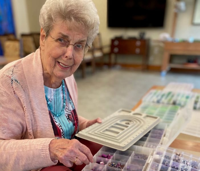 One Woodstock resident looks through beads for her next creation.