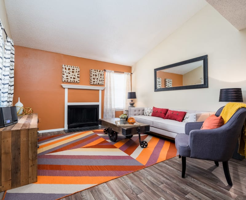 Spacious living room with lots of windows for natural lighting at The Fairway Apartments in Plano, Texas