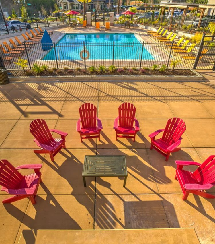 Aerial view of the fire pit deck with surrounding seating overlooking the pool area at Vue Issaquah in Issaquah, Washington