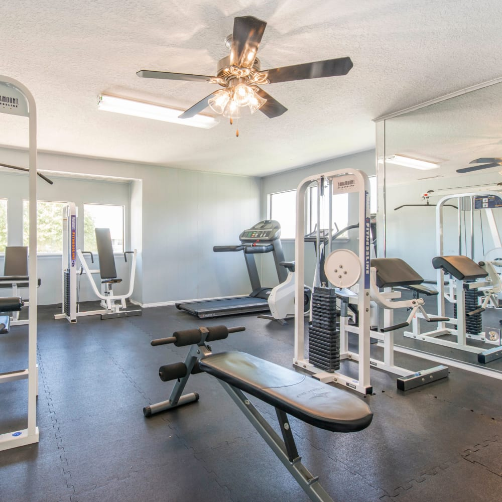 Fitness center with individual workout stations at Compass in Melbourne, Florida