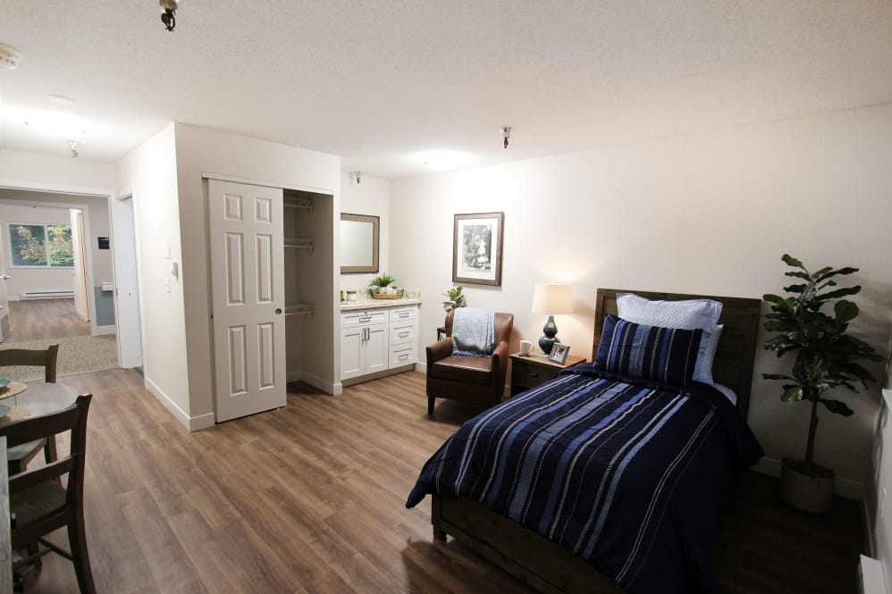Bedroom view with closet and counter space at The Village Senior Living