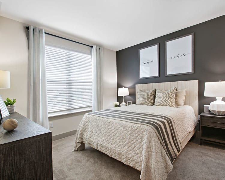 Well lit bedroom with very modern and cute decor in a model home at 8 Metro Station in Charlotte, North Carolina