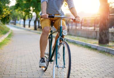 Resident biking to work near Heritage Green in Hilliard, Ohio