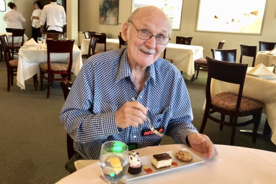 Resident enjoying a special birthday treat at Bella Vista Senior Living in Mesa, Arizona