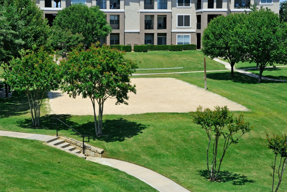 Sand volleyball court at Ballantyne Apartments in Lewisville, Texas