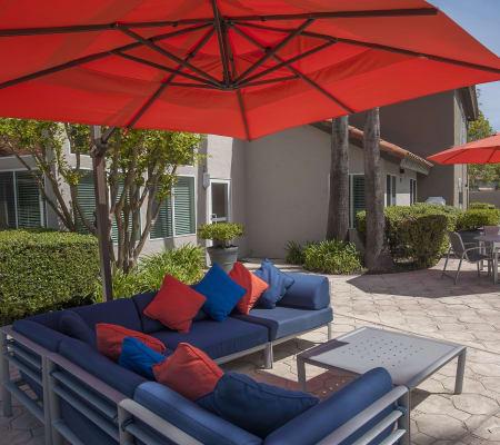 Comfortable outdoor couch with an umbrella at Shore Park at Riverlake in Sacramento, California
