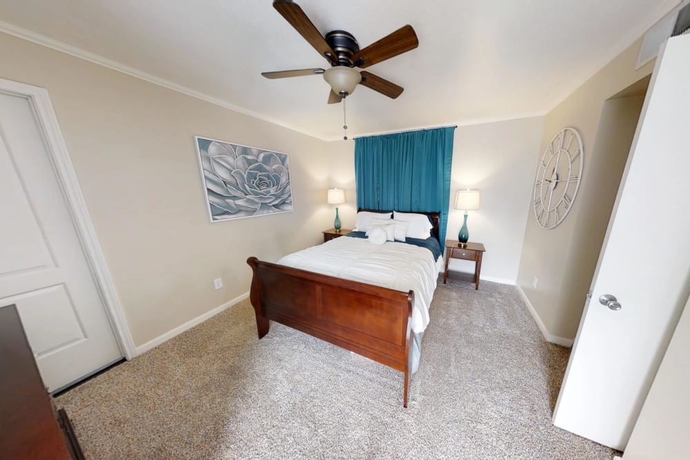 Master bedroom at Falls of Maplewood Apartments in Houston, Texas