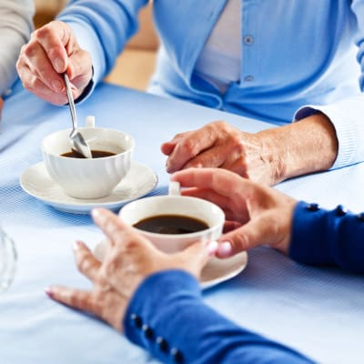 Residents enjoying coffee together at The Sanctuary at West St. Paul in West St. Paul, Minnesota