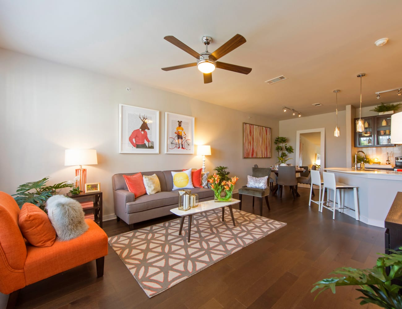 Open-concept layout with hardwood floors at Elite 99 West in Katy, Texas