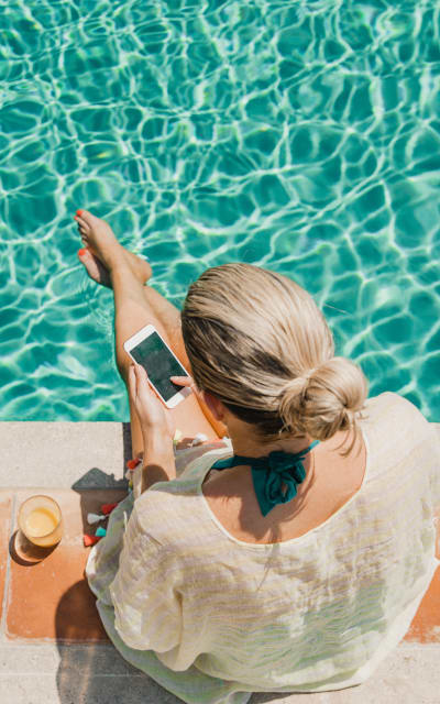 Resident relaxing in Solana Stapleton Apartments's swimming pool in Denver, Colorado